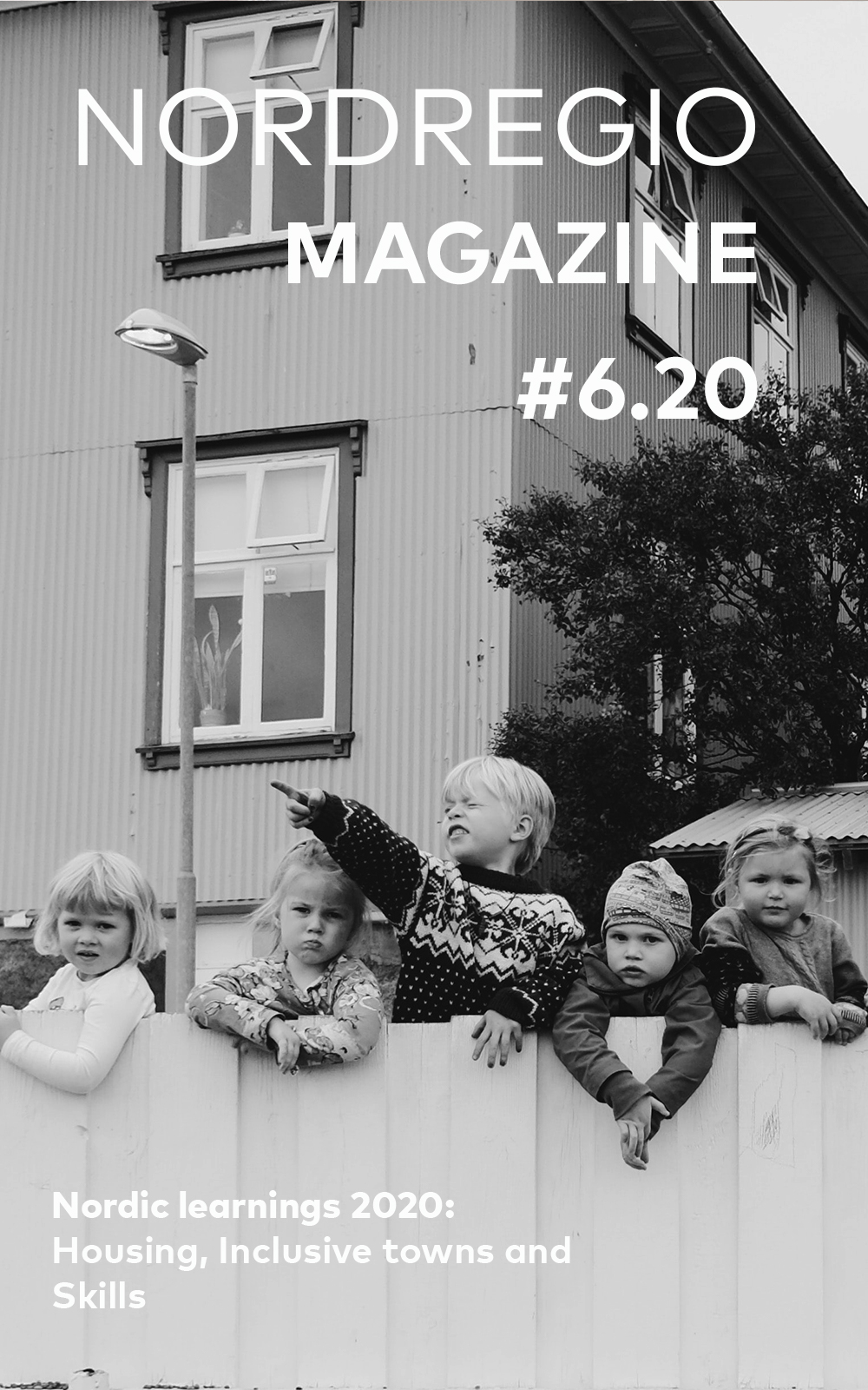 It is the cover of the magazine portraying kids standing by the fence and looking into different directions.